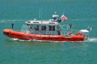A U.S. Coast Guard Rigged Hull Inflatable Boat (RHIB) on Harbor Patrol.