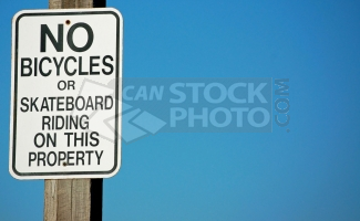 A No Bicycles or Skateboard Riding Sign.